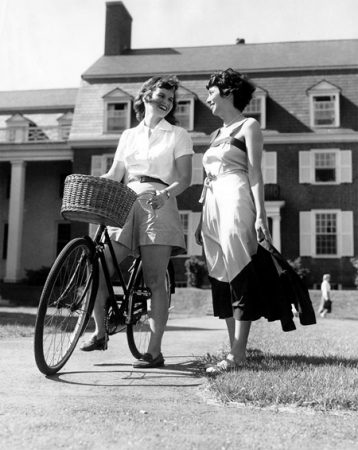 American | Student Activities; students standing with bicycle | Colby College Special Collections