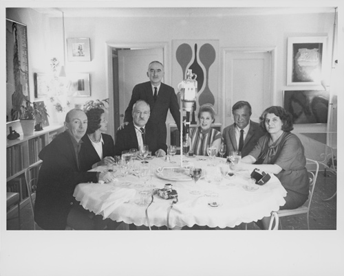 Caption: An afternoon at the Libermans', 1963. Left to right, Lawrence Alloway, Beatrice Leval, Barnett Newman, Alexander Liberman, Sylvia Sleigh, Robert Motherwell, and Annalee Newman. Liberman's ever-present Leica camera is on the table. The Getty Research Institute, Los Angeles, (2000.R.19). © J. Paul Getty Trust.