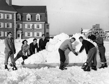 Faculty group prepares snow sculpture | 1949 | Colbiana Photographs | Colby College Special Collections, Waterville, Maine