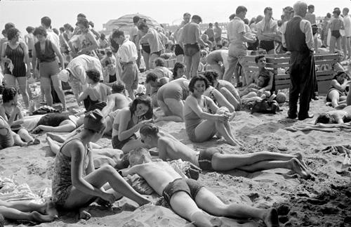 Reginald Marsh [People at Coney Island beach.], ca. 1938, Museum of the City of New York. © 2012 Estate of Reginald Marsh / Art Students League, New York / Artists Rights Society (ARS), New York