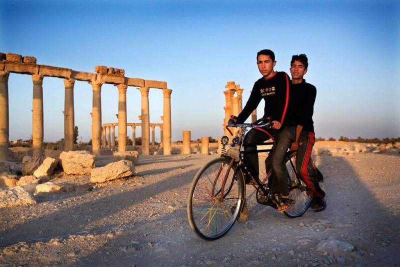 Tim Dirven; Two boys ride a bike at the ruins of Palmyra; 2008; Palmyra, Syria. © Tim Dirven / Panos Pictures