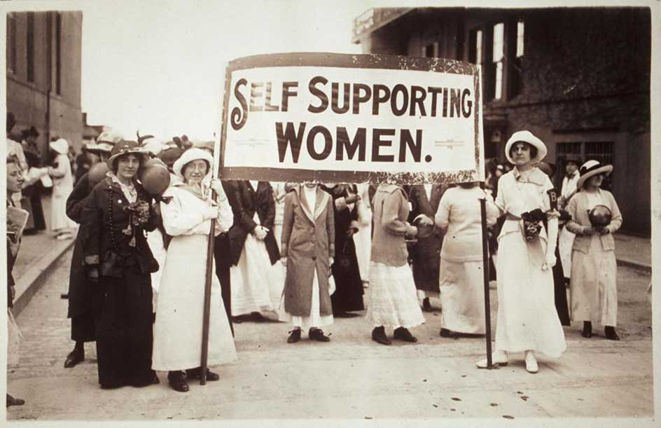 Unknown; Young women holding a sign which reads, 'Self Supporting Women.' Several other women grouped near the banner are holding balls; 1914. This image has been made available by the Schlesinger Library, Radcliffe Institute, Harvard University