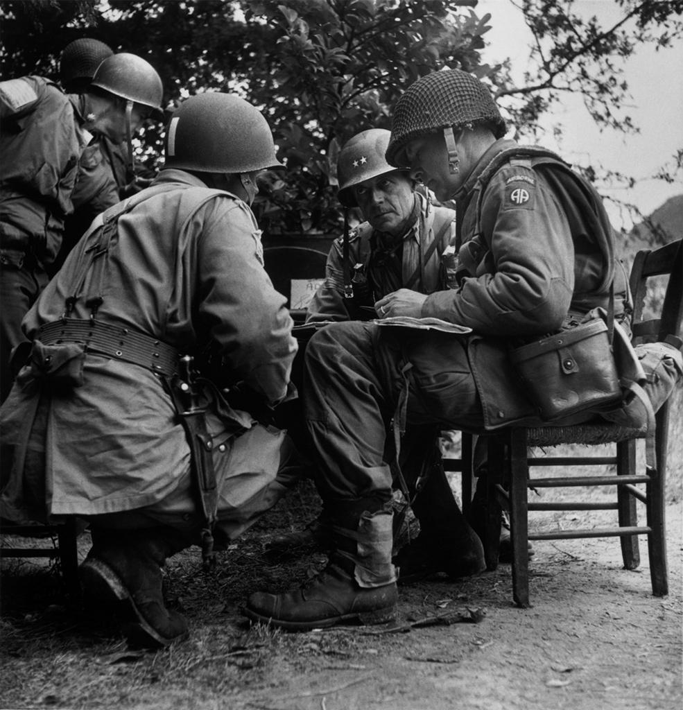 Robert Capa. Normandy; A meeting of Senior American officers; in the middle: Gen. Matthew B. Ridgeway. 1944. ©ROBERT CAPA © 2001 By Cornell Capa / Magnum Photos