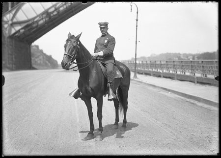 William Davis Hassler. Mr. Sowerby on his horse on the Speedway near High Bridge, New York City, undated (ca. 1905-1911). Washington Bridge visible.|William D. Hassler photograph collection, approximately 1910-1921. William Davis Hassler. Image and data from New-York Historical Society: Museum & Library.