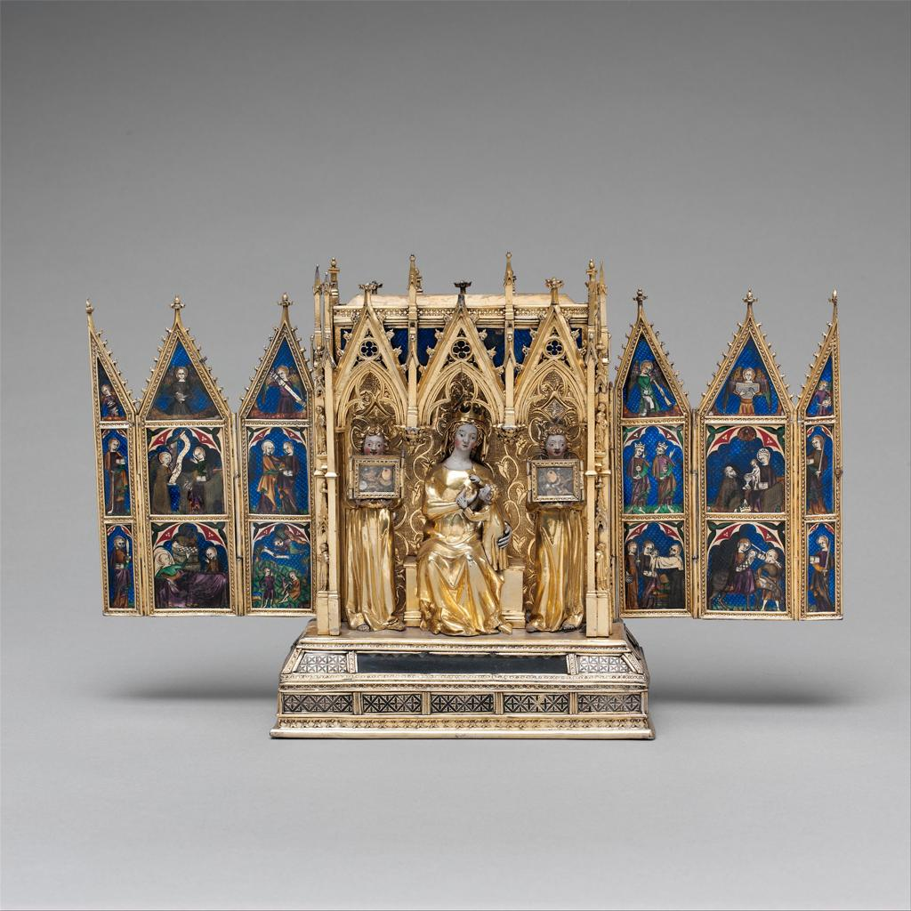 A gilt-silver reliquary with translucent enamel decoration.