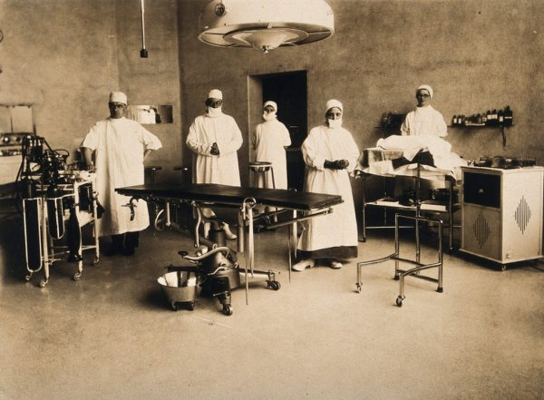 Surgical staff standing in an operating theatr