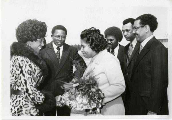 Photograph of Shirley Chisholm greeting a group of people